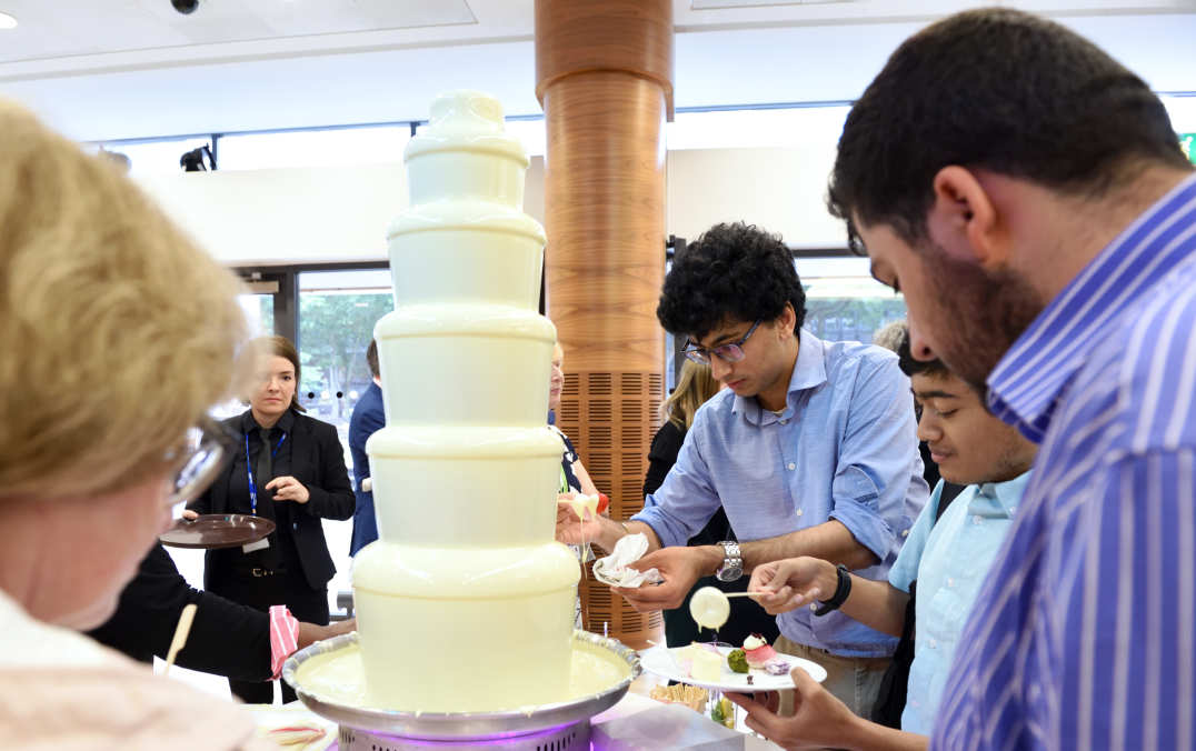 chocolate fountain with staff surrounding it