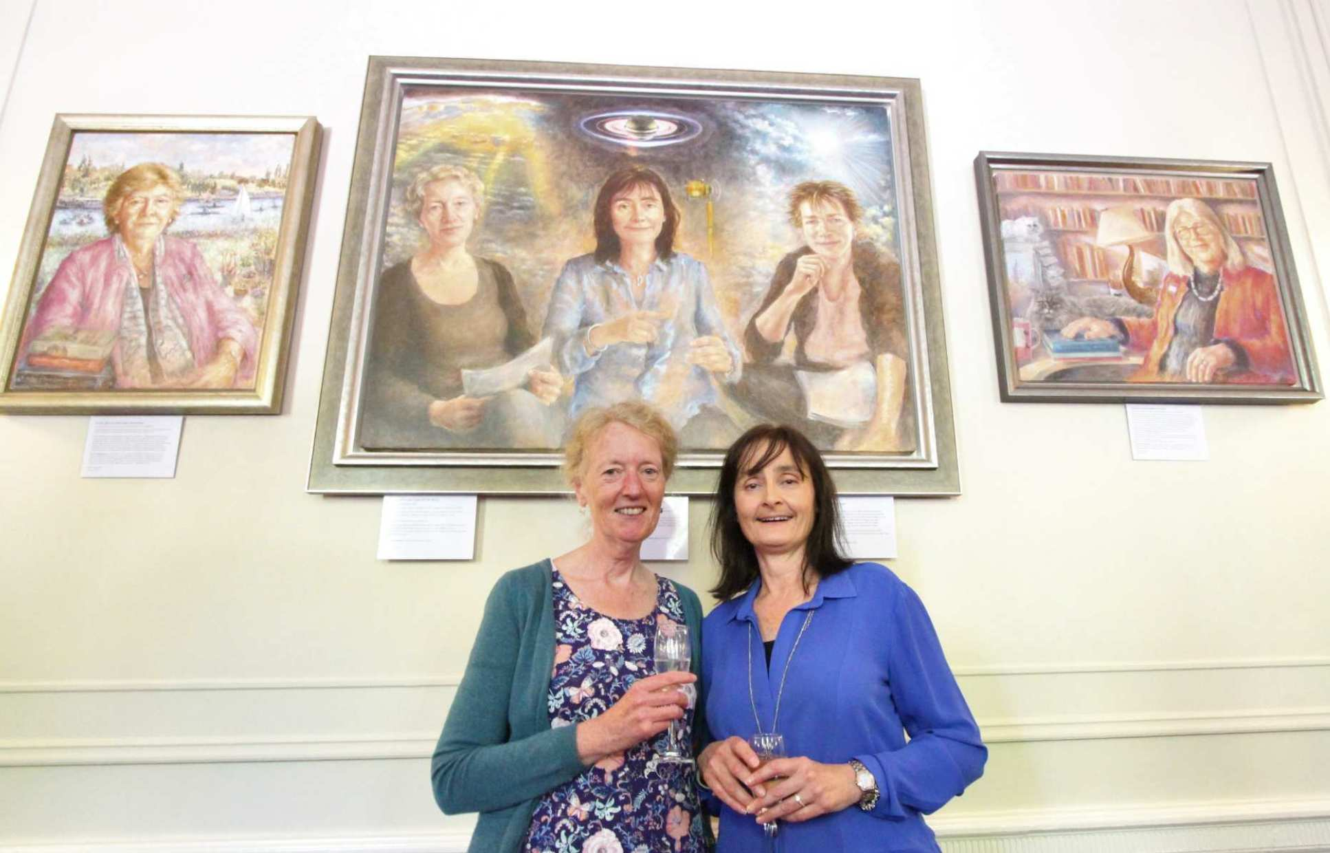 Professor Joanna Haigh (left) and Professor Michele Dougherty (right) in front of their new portrait