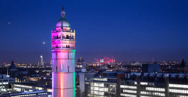 Queen's Tower lit up in rainbow colours