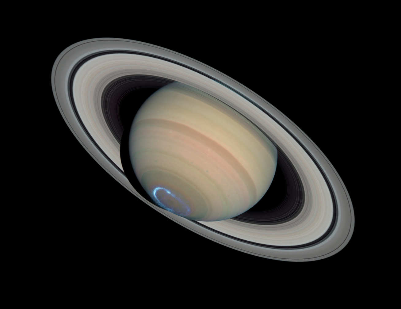Saturn with a blue-white ring around the south pole