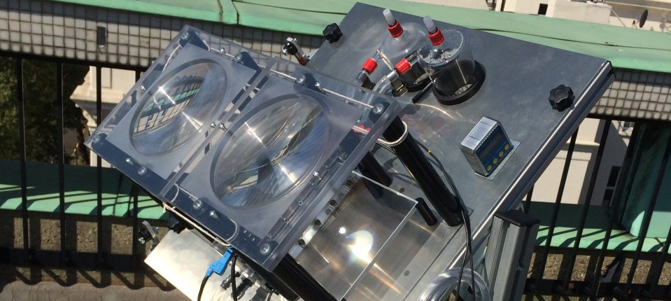 Our reactor operating under concentrated light - we used two large fresnel lenses and waveguides