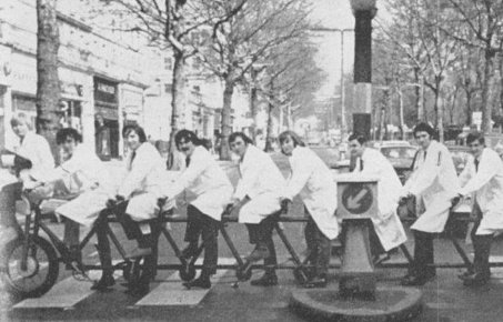 Medical students on a large bicycle outside St Mary's hospital