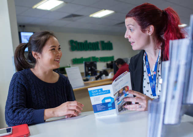 Student receiving advice in the Student Hub