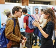 careers consultant chatting to a student at an event