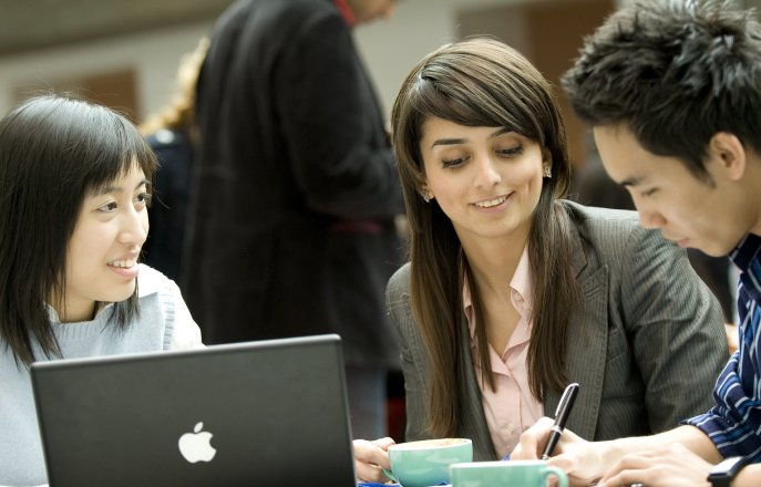 Business School students working