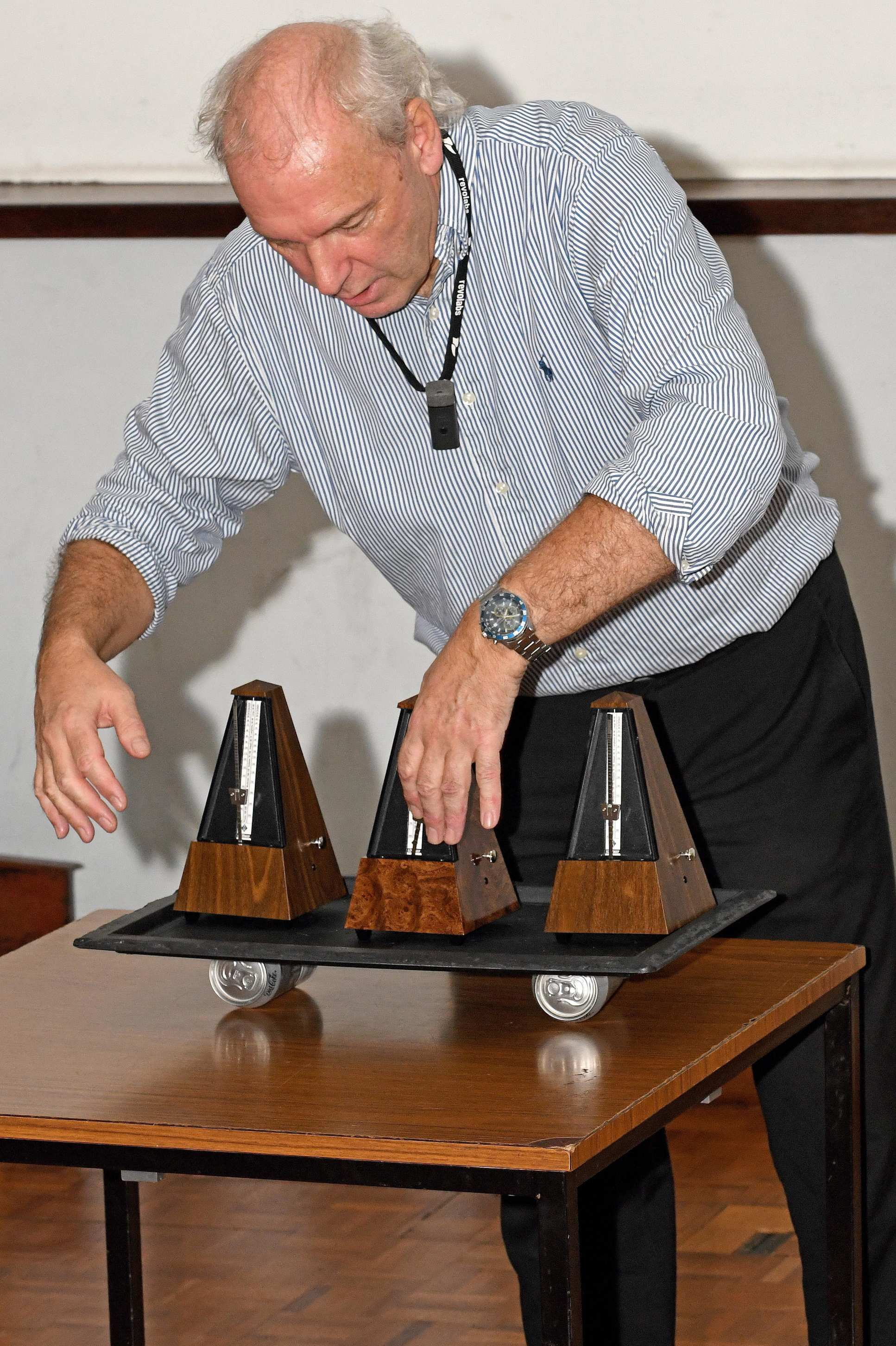 Professor Ken MacLeod uses metronomes to illustrate the re-synchronisation of heart cell rhythms during his inaugural lecture