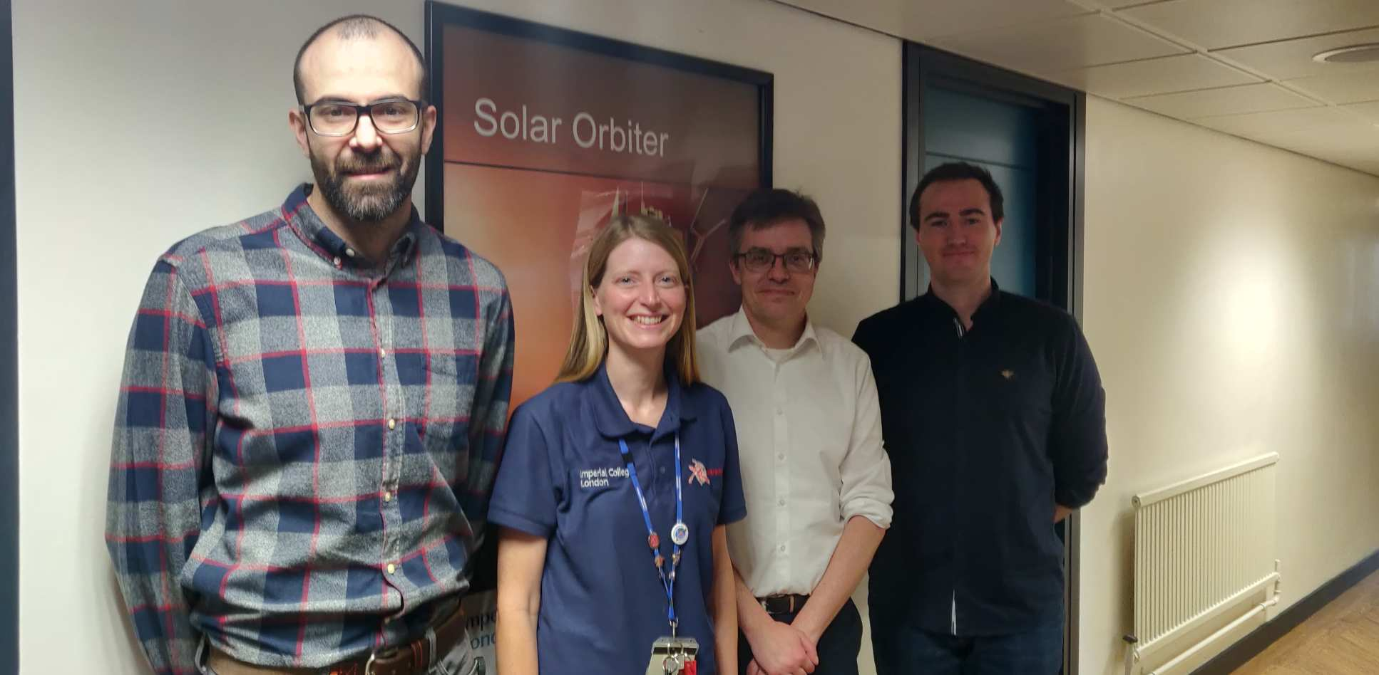 People in front of a Solar orbiter poster
