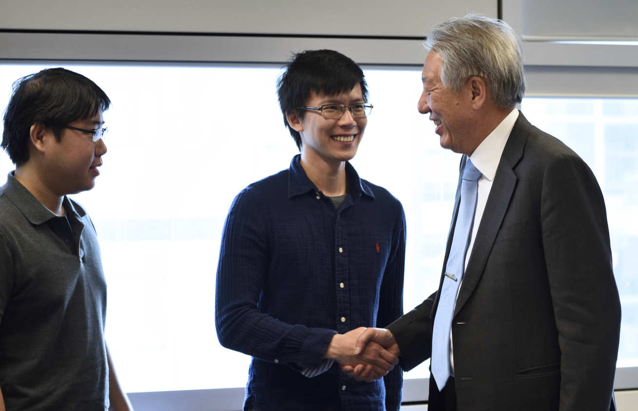 Mr Teo discuss synthetic biology with students Sean Lee and Garret Wong