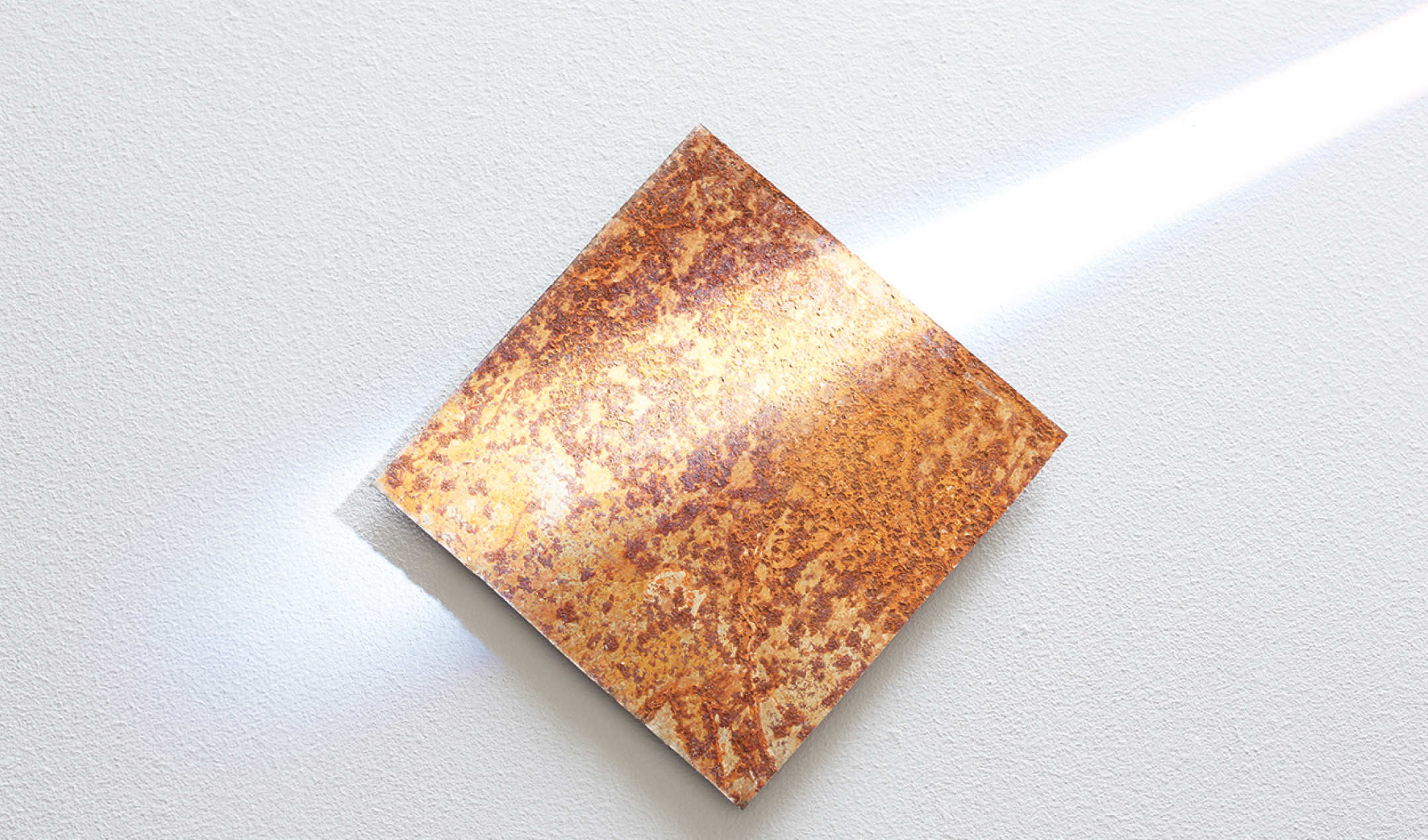 A square plate covered in rust