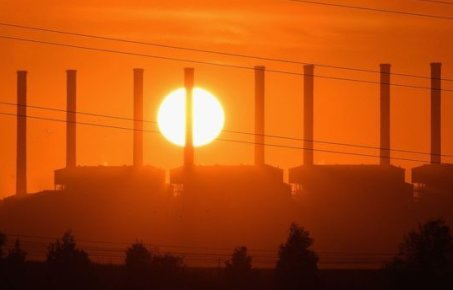 A power station and line of chimneys at sunset