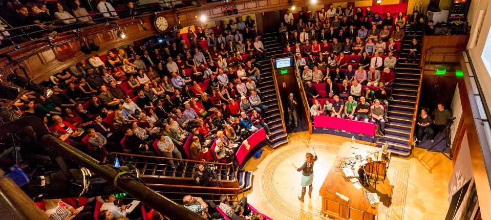 Presenter and audience in the Theatre at the Royal Institution