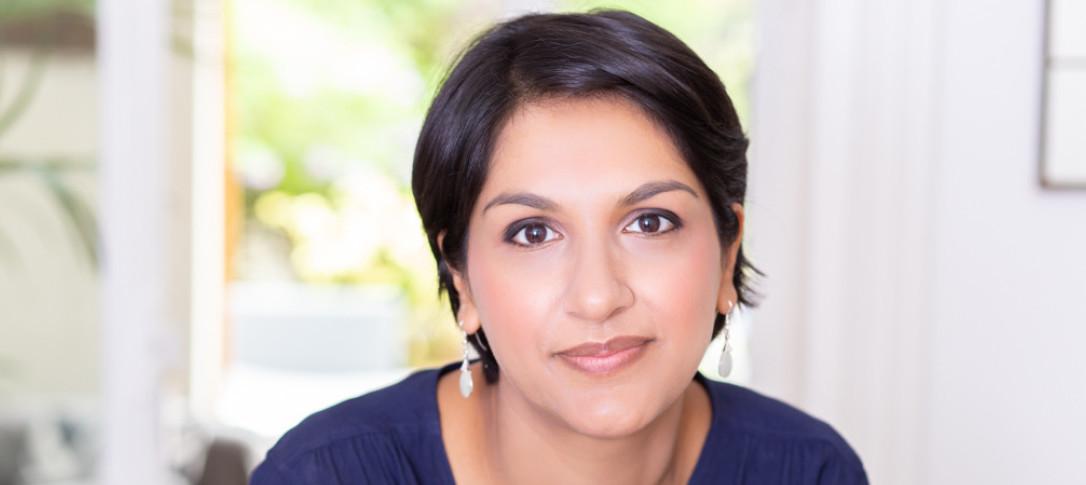 Author Angela Saini looking at the camera