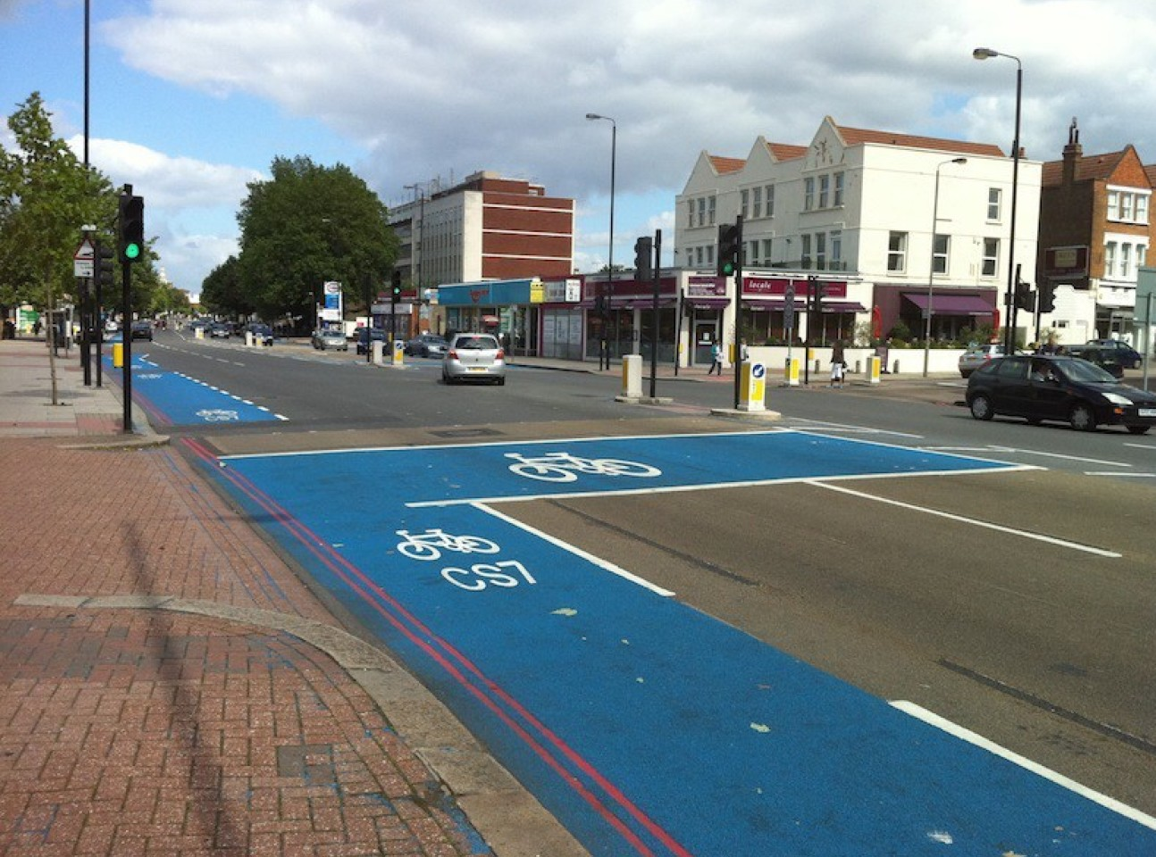Cycle lane in blue along a main road