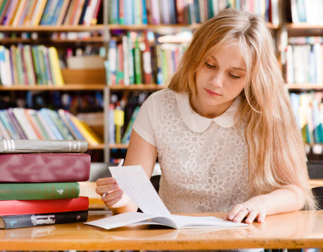 Female student with a pile of books