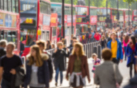 A shot of people walking in front of London buses
