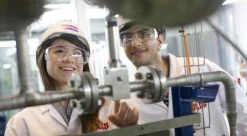 Students using machinery