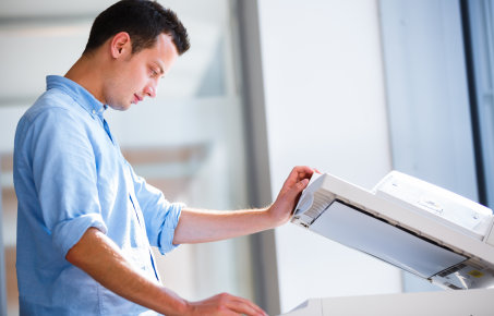 Man using a photocopier