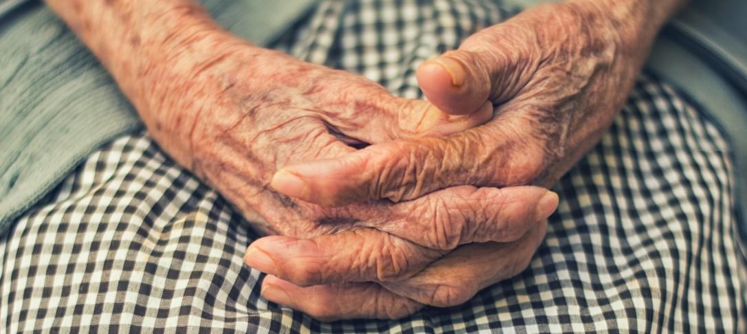wrinkled hands of elderly woman