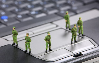 Tiny toy soldiers guarding a computer
