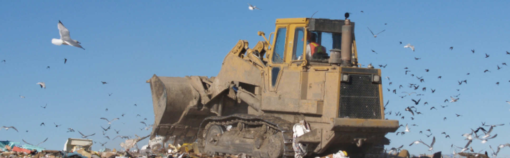 A digger on a landfill site