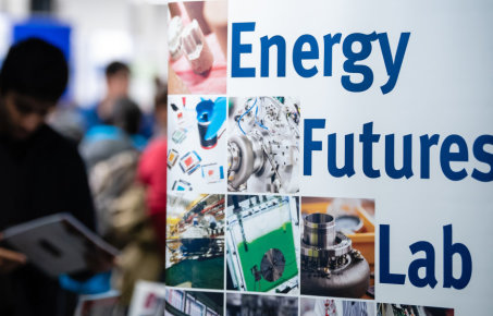 energy futures lab poster and attendees at event in background