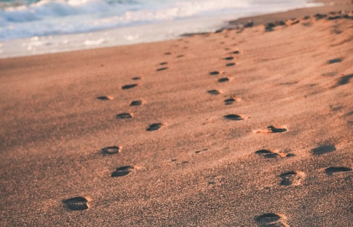 two sets of footprints in the sand