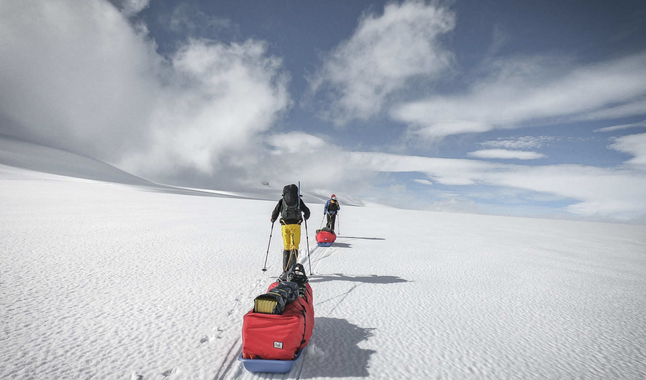 Two students hauling a sledge in Norway