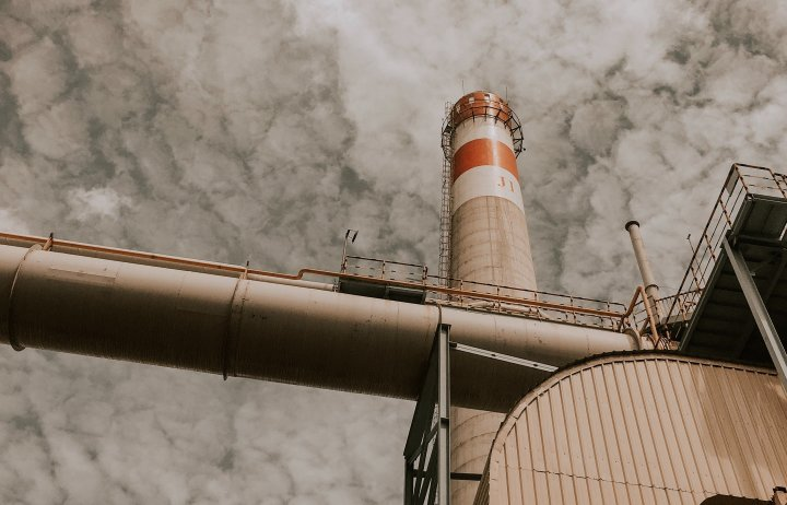 View of a factory tower from below
