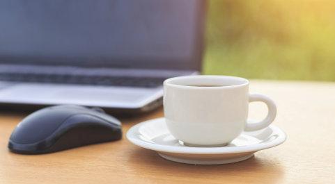 Coffee cup and mouse