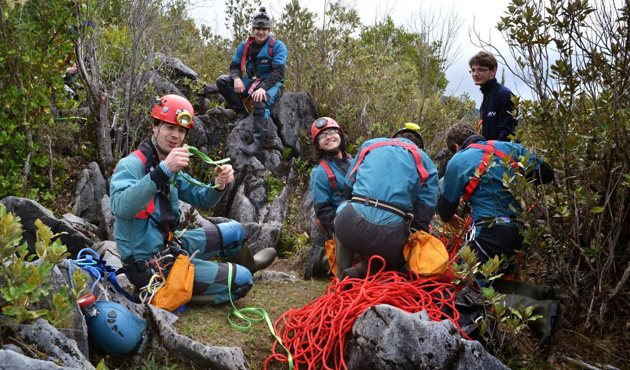 A group of students preparing to go caving