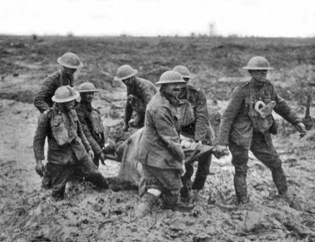 WWW1 soldiers carrying stretchers in the field