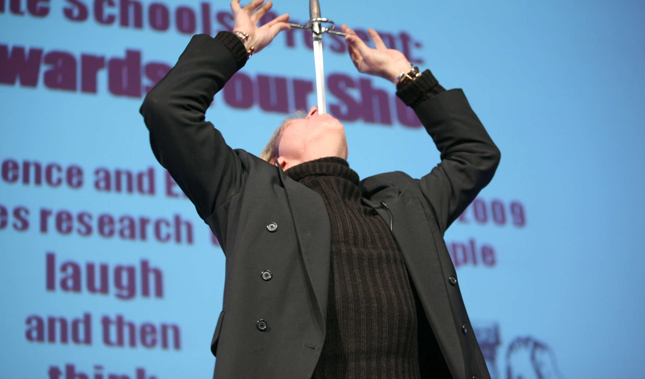 A man swallowing a sword at the Ig Nobel Awards show