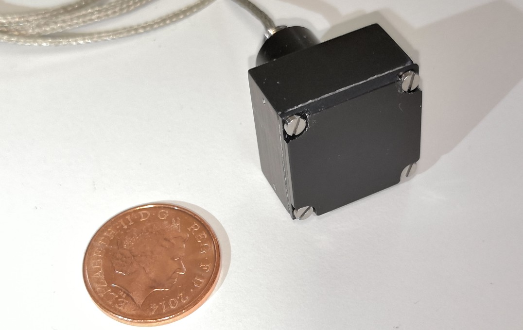 Small black box next to 1p coin