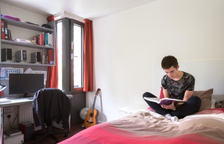 A student in his room in halls
