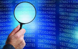 A magnifying glass hovers over a list of data.