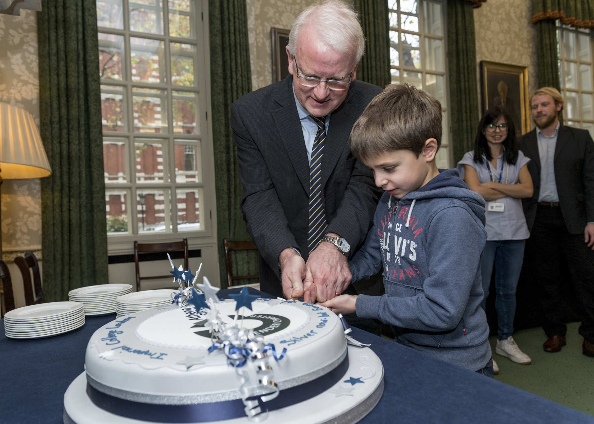 James Stirling cutting cake
