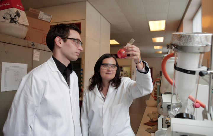 Man and woman in a lab inspecting something in a tube