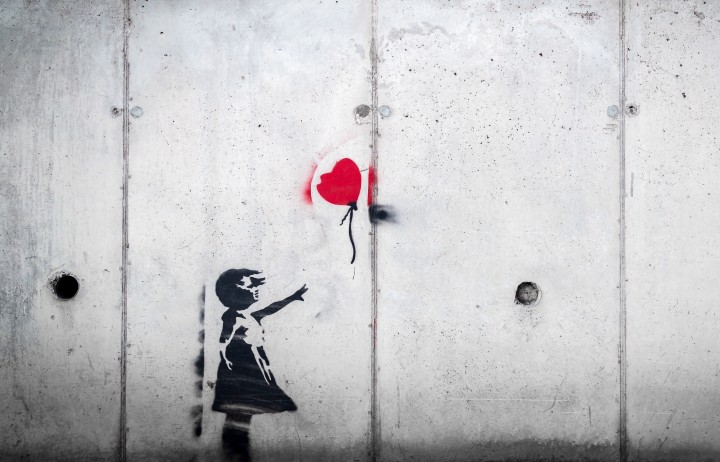 banksy wall art, girl letting go of heart balloon