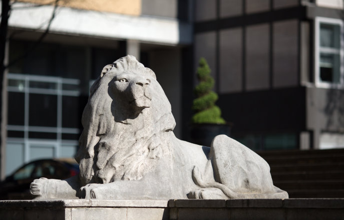 The lion at the base of Queens's Tower