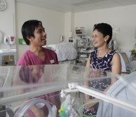 Professor Neena Modi next to an incubator in the neonatal unit