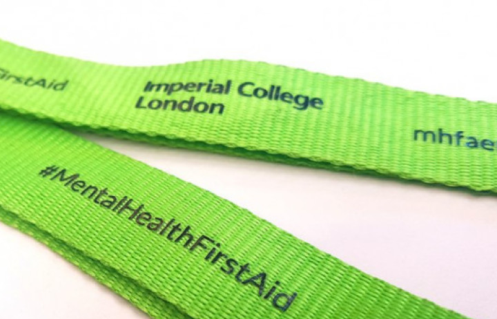 Part of the green Imperial College London Mental Health First Aid lanyard