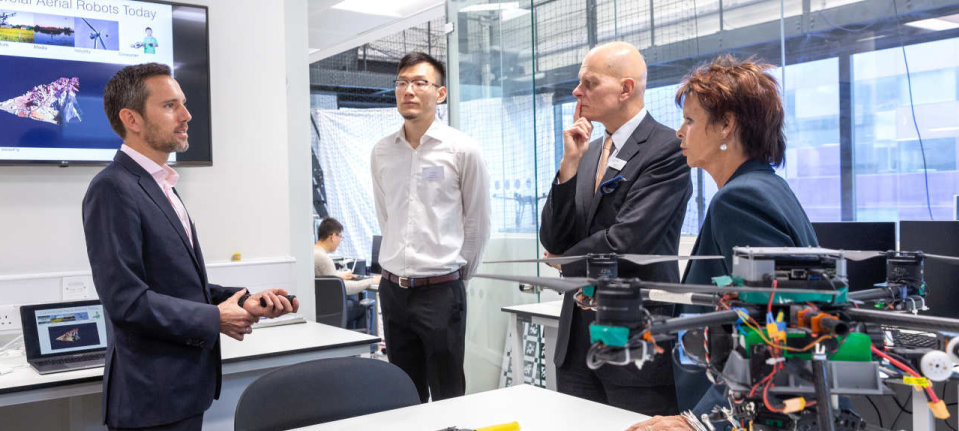 Dr Mirko Kovac and Dr Chang Liu welcomes Provost Ian Walmsley and Skills Minister Anne Milton to the Aerial Robotics Lab