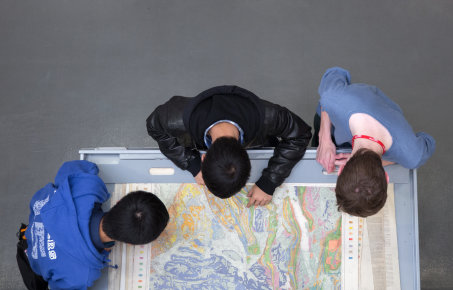 Students looking at a large map