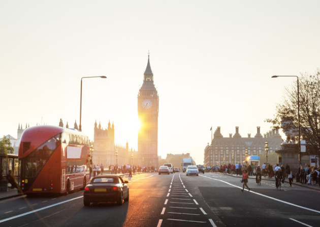 parliament at sunset with buses and cars