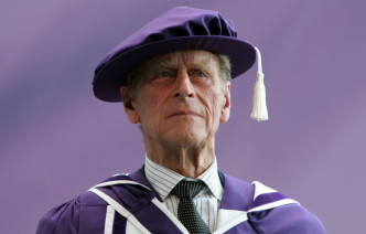 The Duke of Edingburgh dressed in Imperial robes receiving his honorary doctorate
