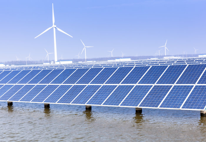 Solar panels and wind turbines in water