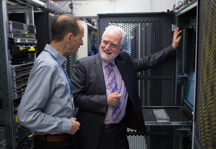 Institute for Security Science and Technology Director Professor Chris Hankin speaks with Institute Manager Andrew Burton at a computer terminal