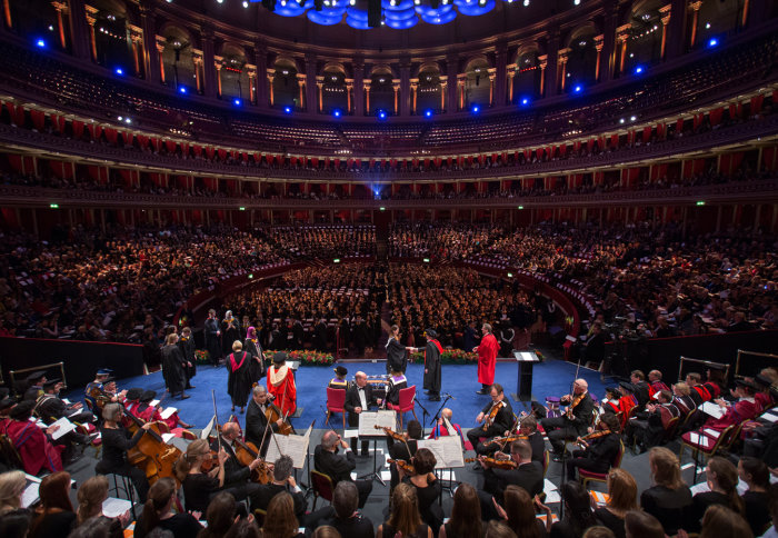 View of the Royal Albert Hall from the back of the stage with graduates being honoured
