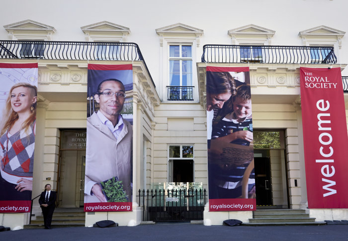 Front of the Royal Society building with large red welcome banners