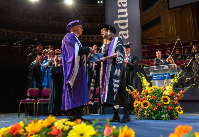 Professor James Stirling receiving his honorary doctorate from President Alice Gast